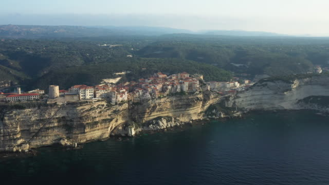 View from above, stunning aerial view of the old village of Bonifacio built on a limestone cliff. Bonifacio is a commune at the southern tip of the island of Corsica, France.