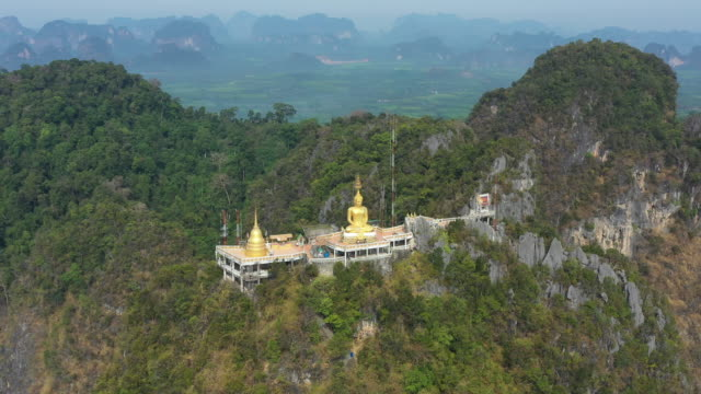 View from above, stunning aerial view of the Tiger Cave Temple (Wat Tham Sua) surrounded by amazing ridges of limestone mountains. Krabi, Thailand.