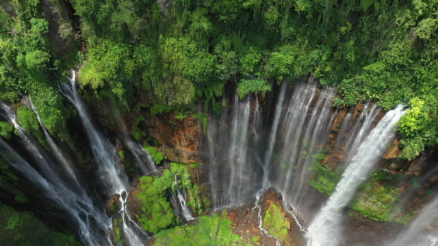 View from above, stunning aerial view of the Tumpak Sewu Waterfalls also known as Coban Sewu, East Java, Indonesia. View from above, stunning aerial view of the Tumpak Sewu Waterfalls also known as Coban Sewu. indonesia stock videos & royalty-free footage