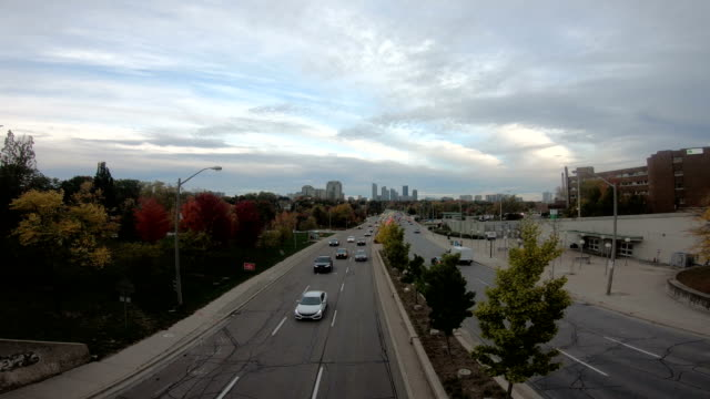 Video View from an overpass of the 401 Highway with Toronto city in Background