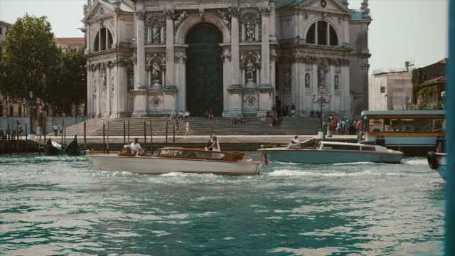 View From Gondola In Venice. Basilica Of The Virgin Mary Healing. View From Gondola In Venice. Basilica Of The Virgin Mary Healing. Brides Swim In A Boat Past The Temple. renaissance architecture stock videos & royalty-free footage