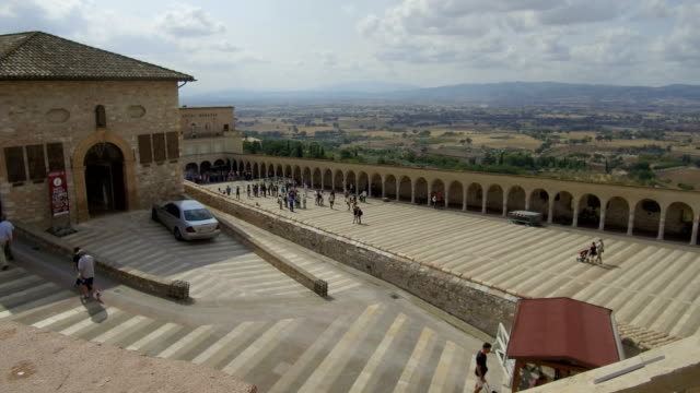view from high basilica with pilgrims, assisi