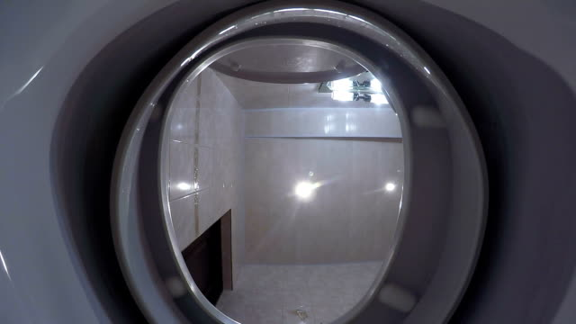 View from inside the toilet bowl with flushing water video