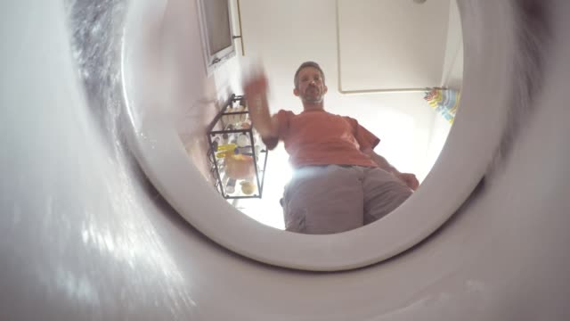 A view from inside the toilet with water flushing down A view from inside the toilet with water flushing down bathroom stock videos & royalty-free footage