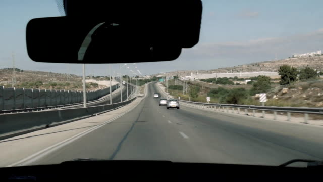 View from moving car on israeli road, in the side separating wall. video