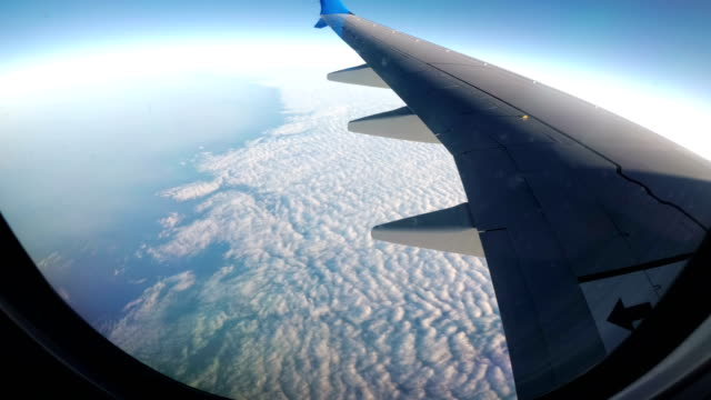 View from the Airplane Window on a Landscape of Clouds video