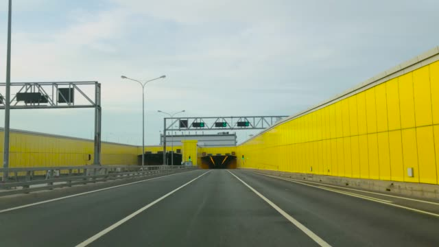 View from the car on the highway, the entrance to the tunnel
