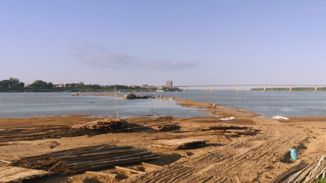 View from the island. Bamboo bridge under construction