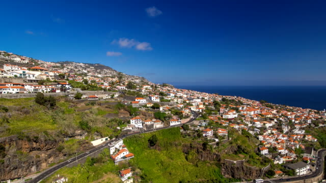 View from the mountain over the rooftops from cable car on Madeira timelapse hyperlapse View from the mountain over the rooftops from cable car on Madeira timelapse hyperlapse.  The modern landscape. Funchal, Portugal. funchal stock videos & royalty-free footage