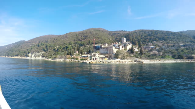 view from the sea to the temple on the holy mount athos in greece - религиозные тексты стоковые видео и кадры b-roll