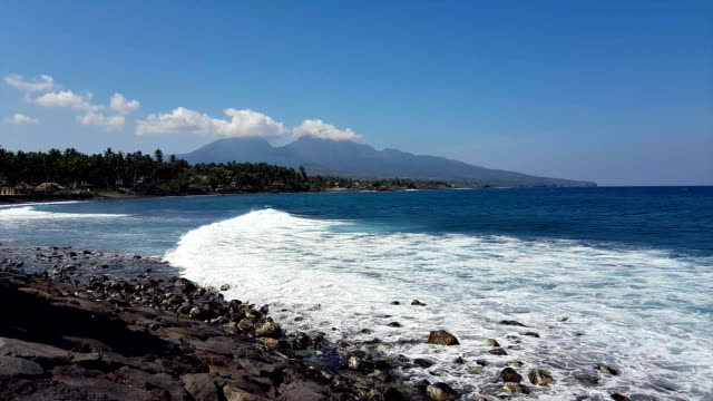 View from the shore of the ocean to Active volcano Gunung Agung in Bali, Indonesia. video