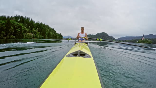POV View from the stern of a male athlete rowing video