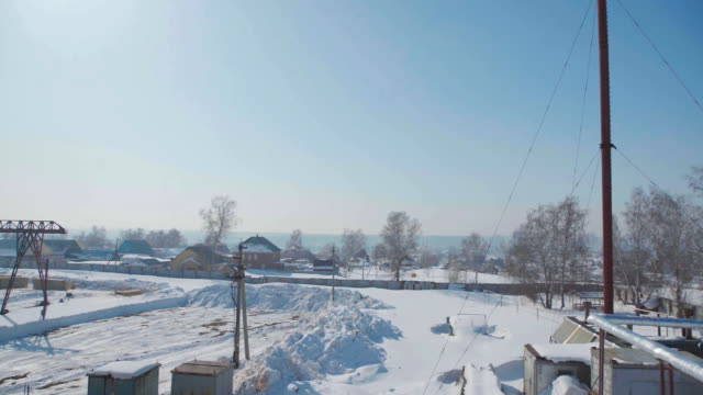 View from the window on the industrial base: a wasteland, white snow video