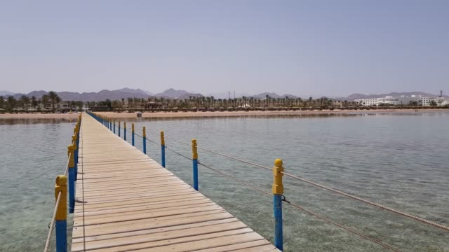 View from the wooden pier to the beach near the hotel. video