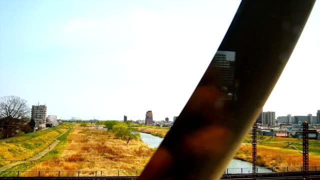 view from windows of high speed train in japan. - wagon kolejowy filmów i materiałów b-roll