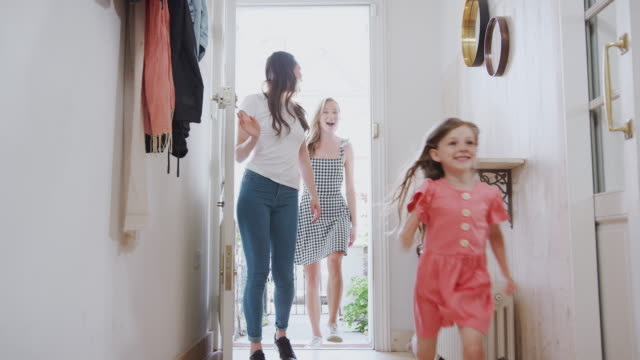 View Inside Hallway As Same Sex Female Couple With Daughter Open Front Door Of Home View from hallway as same sex female couple with daughter open front door of home and she runs ahead - shot in slow motion lesbian stock videos & royalty-free footage