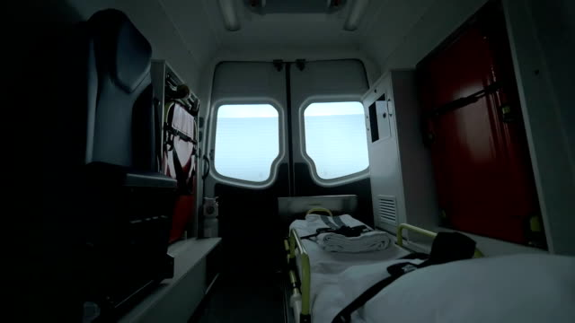 View inside of driving empty ambulance car View inside of driving empty ambulance car. Ready for using stretcher with white clean bedsheet medevac stock videos & royalty-free footage