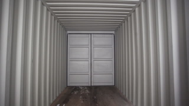 View inside of spacious empty cargo trunk of the truck with metal covering, transportation and trucking industry concept. Stock footage. Inside the metal container