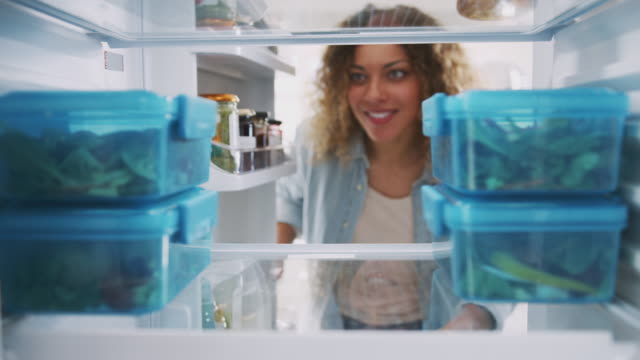 View Looking Out From Inside Of Refrigerator As Woman Takes Out Healthy Packed Lunch In Container View from inside fridge as woman opens door and takes out pre-prepared meals in plastic containers - shot in slow motion fridge stock videos & royalty-free footage