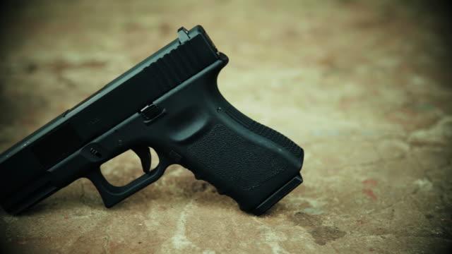 View of a black handgun on a concrete background