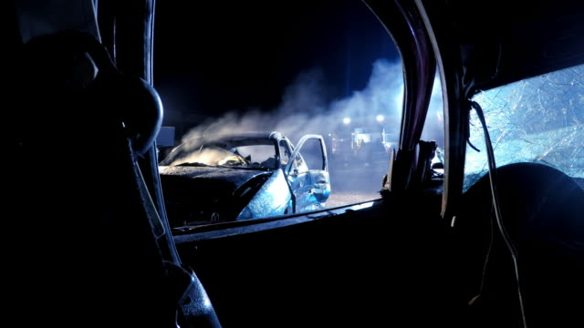 POV View of a burnt out car at night from another car Point of view shot of a burnt out car viewed from another vehicle. Shot in Slovenia. car accident stock videos & royalty-free footage