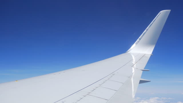 View of airplanes wing from its window during the flight video