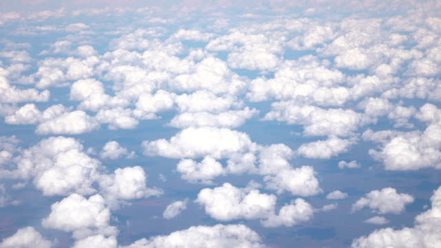 SLOW MOTION: View of arid landscape and numerous puffy white clouds video