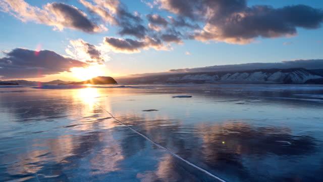 vídeos de stock e filmes b-roll de view of baikal lake. covered with snow. - lago baikal