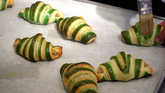 4K view of baked buns with green stripes
