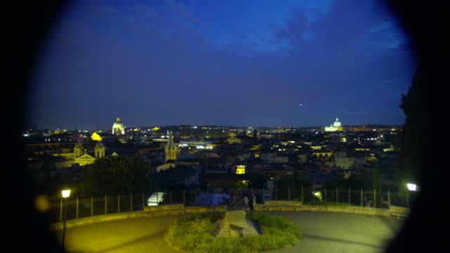 utsikt över vackra panorama över natt rom genom teleskop på observationsdäck - påve bildbanksvideor och videomaterial från bakom kulisserna