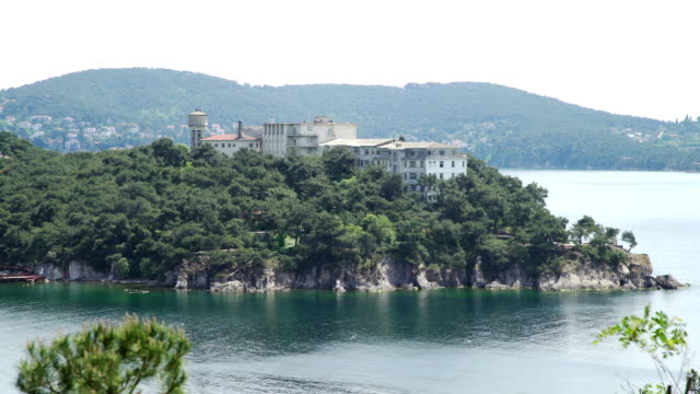 View of big house on sea coast of Island View of bay of Adalar Island, Turkey diving to the ground stock videos & royalty-free footage
