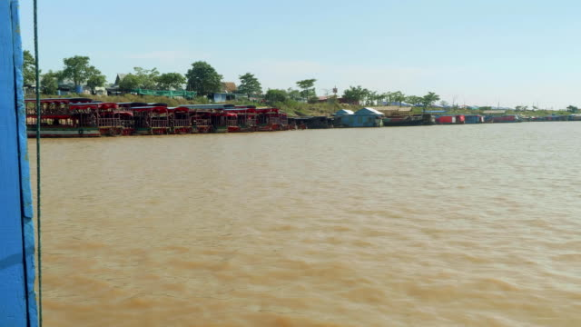 View of boats and little houses along ahore of lake Tonle Sap video