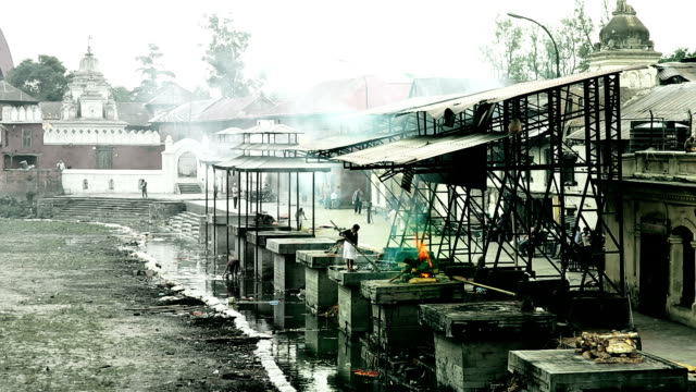 View of body cremation grounds, pashupatinath temple, kathmandu, nepal. retouched video