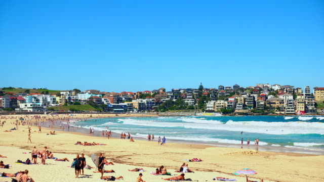 view of Bondi Beach or Bondi Bay at sunny day in Sydney, people relax at Bondi beach video