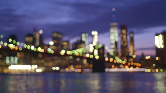 View of Brooklyn Bridge with the distinctive New York skyline in background at sunset video