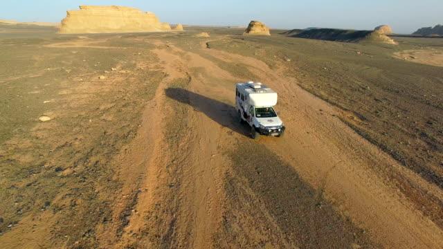 AERIAL View of car driving on gobi desert,Xinjiang, China.
