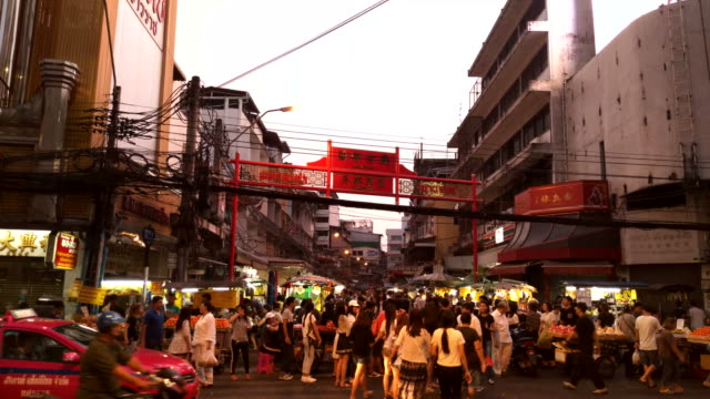 View of China town in Bangkok. People bustling around the area. Traffic is on the road. Yaowarat Road (China Town) is famous for street food and lively environment. video