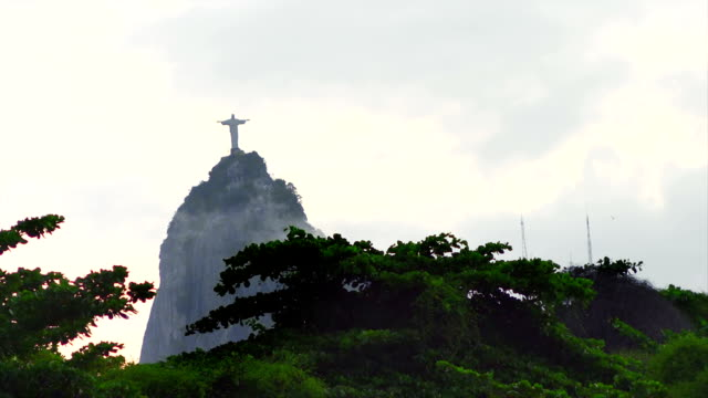 View of Christ the Redeemer statue on a mountain in Brazil View of Christ the Redeemer statue on a mountain in Brazil cristo redentor stock videos & royalty-free footage