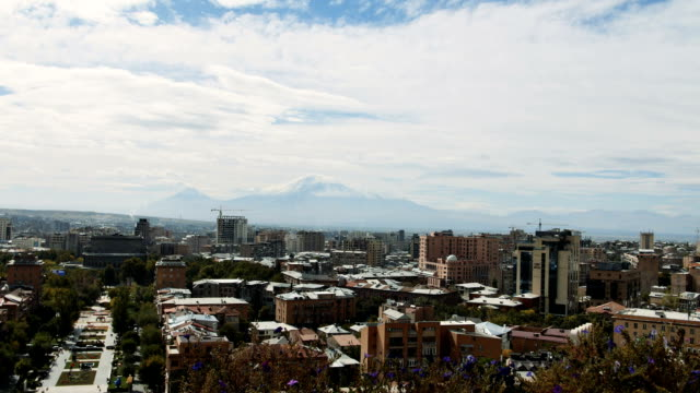 View of clouds above the Yerevan city with huge mountain ARARAT behind video