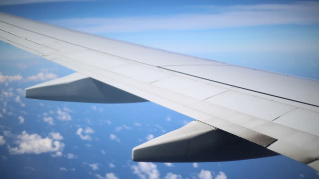 View of Clouds from Inside of an Airplane video