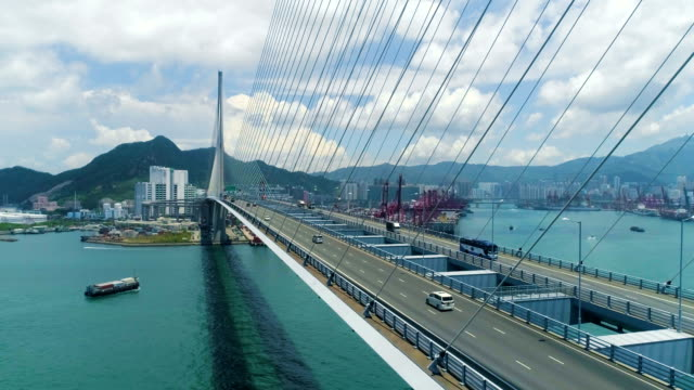 vídeos de stock e filmes b-roll de view of container terminals through stonecutter bridge. aerial drone shot - ponte