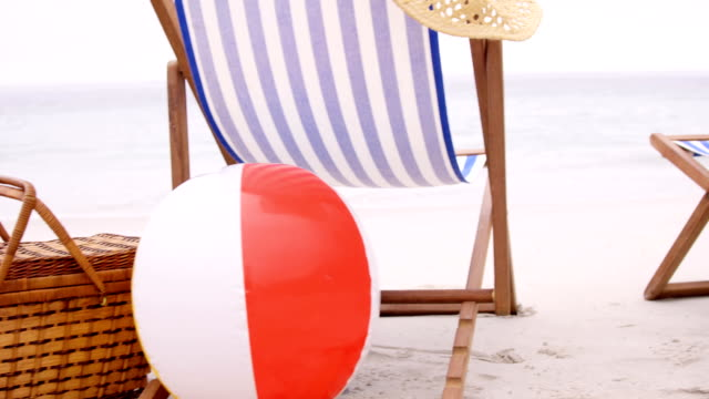 View of deckchairs on the beach video