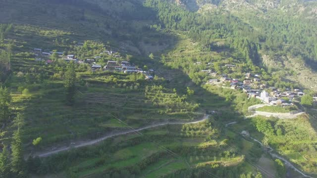 View of Dharali village situated in river Ganges valley, village is famous for its apple orchards in the valley in Himalaya region.