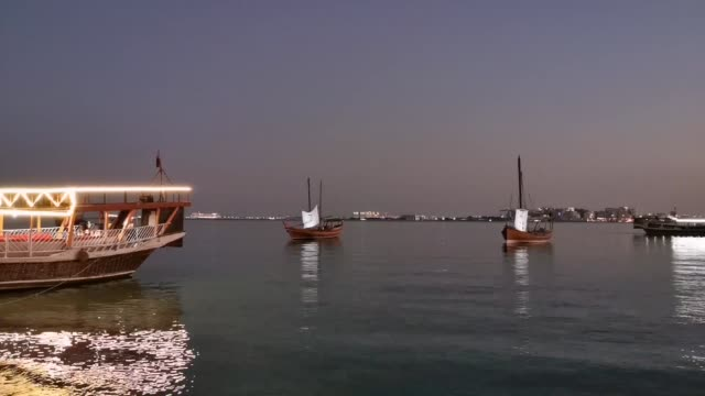 view of doha corniche during the sunset - souk video stock e b–roll