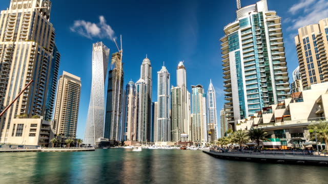 view of dubai marina towers in dubai at day time timelapse hyperlapse - paesi del golfo video stock e b–roll