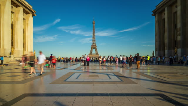 View of Eiffel Tower from Trocadero with crowds of tourists - 4k time-lapse