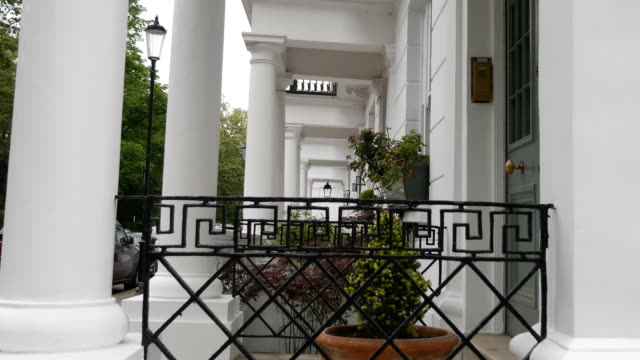 View of entrances to residential houses with columns. London. England. Europe. Streets, architecture and details of the city. victorian architecture stock videos & royalty-free footage