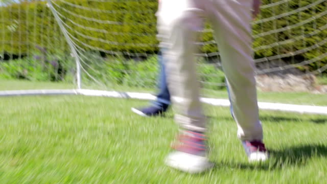 View Of Feet As Grandfather And Grandchildren Play Football video