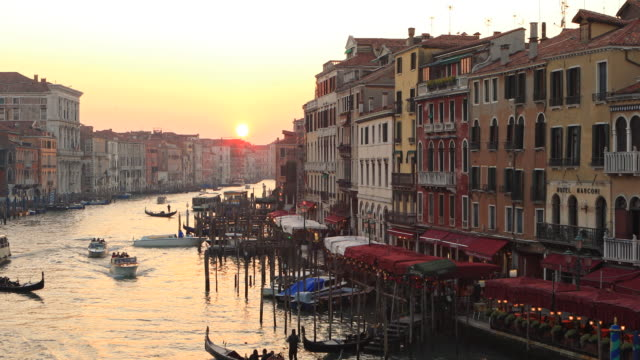 View of Grand Canal From Rialto Bridge, Venice, Italy Venice is a city in northeastern Italy and the capital of the Veneto region. It is situated across a group of 118 small islands that are separated by canals and linked by bridges, of which there are 400. european culture stock videos & royalty-free footage