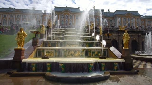 View of Grand Cascade fountains stairs with sculptures in Peterhof Saint Petersburg, Russia